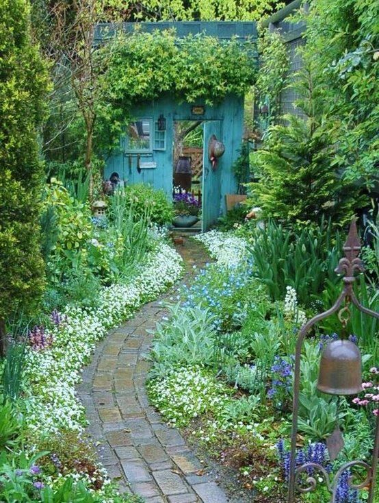 Beautiful cottage garden design (Christmas tree is a little odd) I like the winding path.