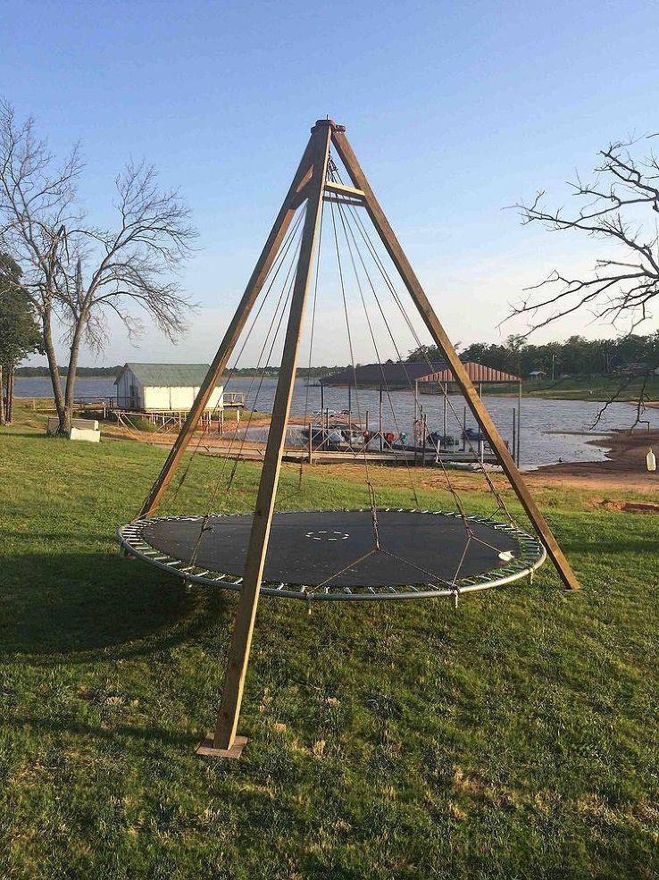Trampoline turned backyard lounge swing trampolines for Trampoline porch swing