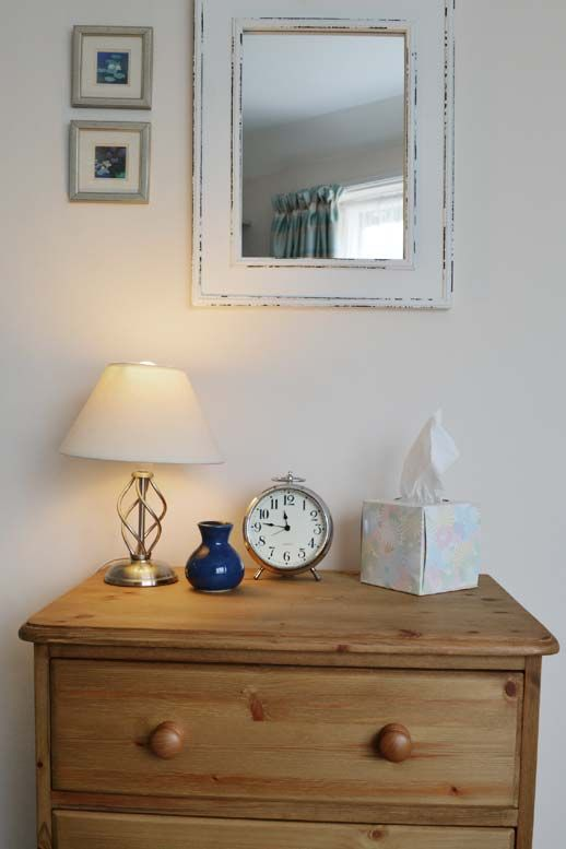 Rustic pine chest of drawers in the twin bedroom