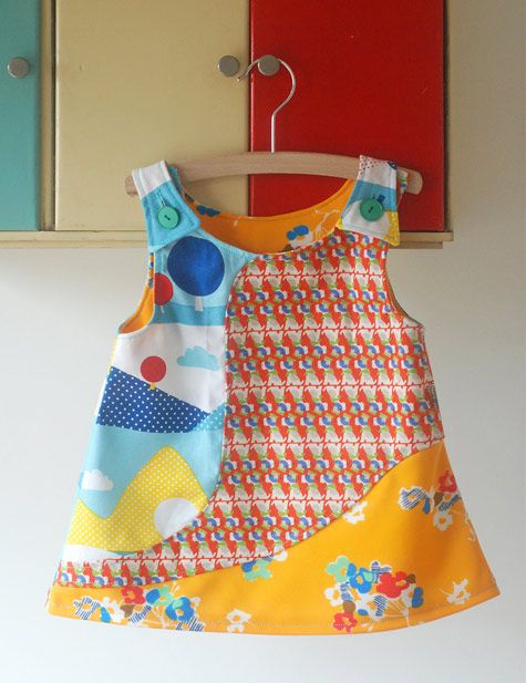 Tri-pattern colorful little girl dress designed and sewn by Nina van de Goor of Ninainvorm blog and her mother-in-law.