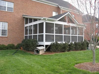 Screened porch with shed roof and false gable outdoor for Shed roof porch designs