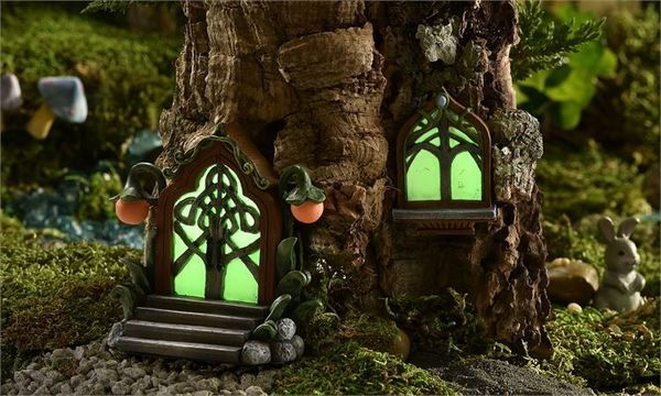 Mini World Glow-in-the-Dark Door & Window Accessory.  Includes glow in the dark fairy door and window.  Ornate textural and floral detailing.