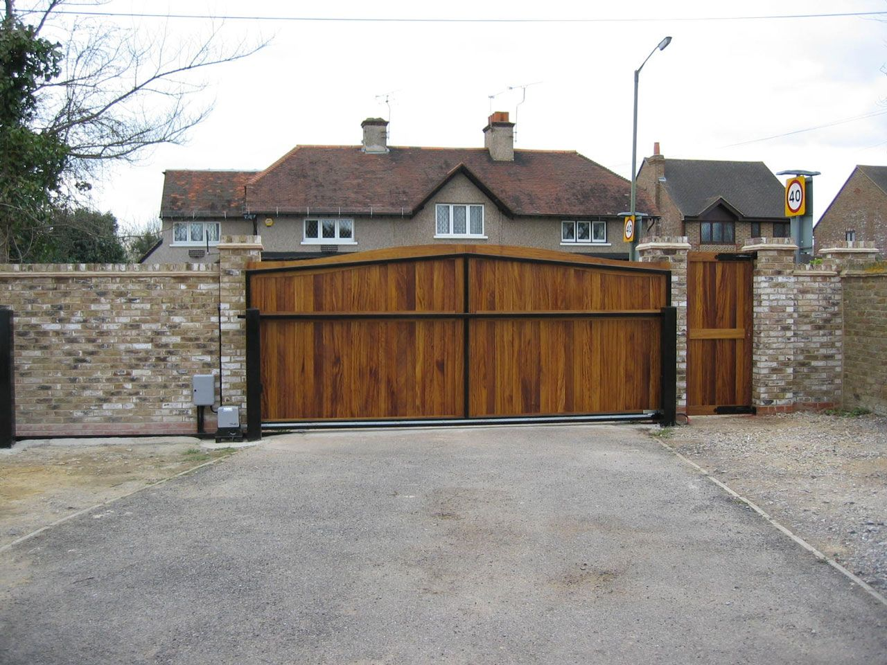 Gate Design Ideas front gate designs for homes home gate design huge on main gate home gate design Traditional Hardwood Gate Design Ideas Feat Exposed Brick Wall Front Yard Fence And Chimneys