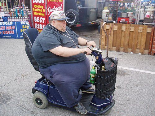 Overweight patient on mobility scooter