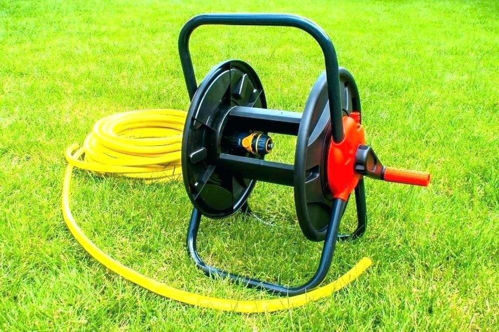 Installing The Wall Mounted Garden Hose Reel In 2020 Garden Hose Reel Hose Reel Garden Hose