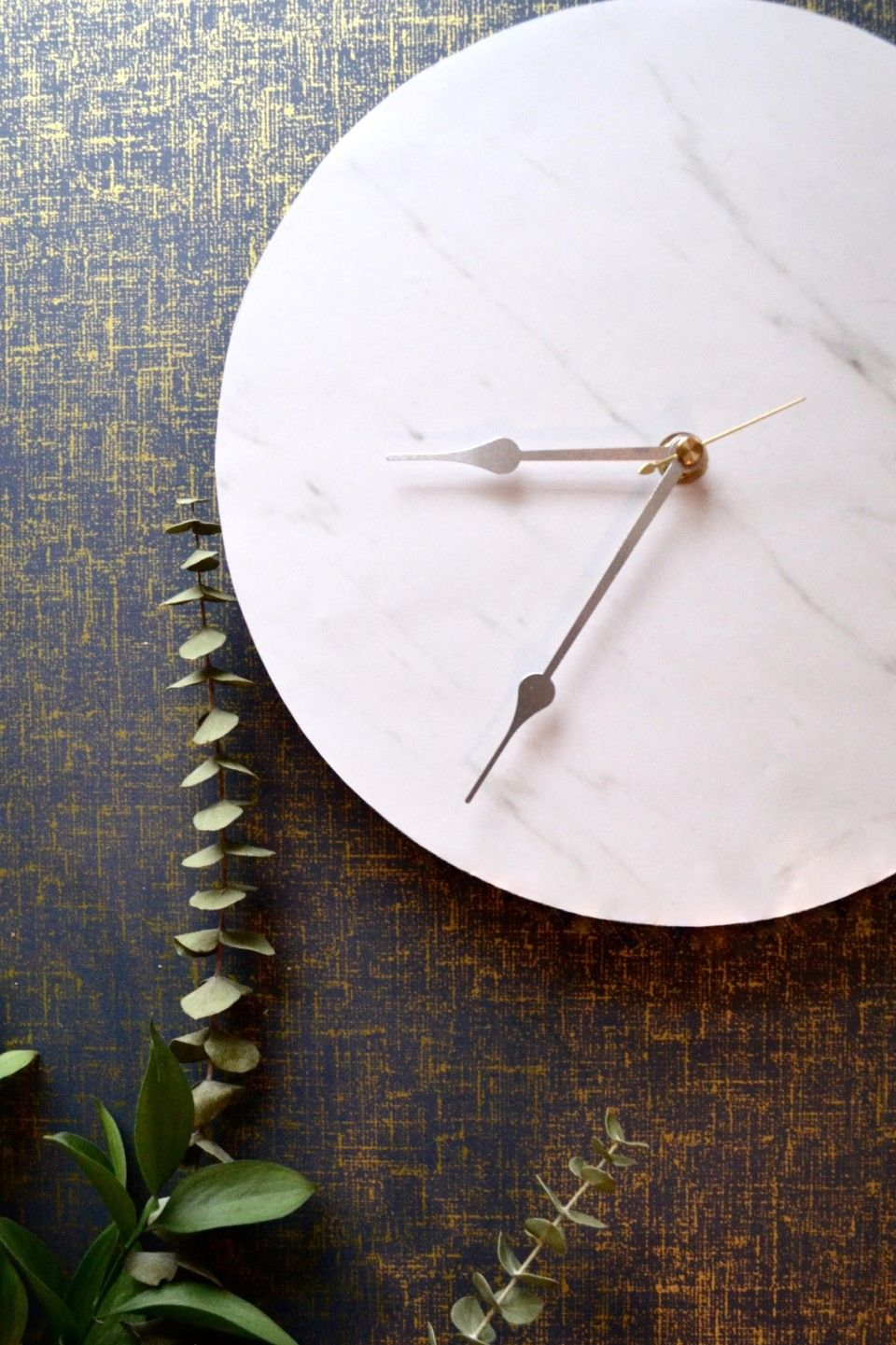 Make a faux marble clock. Just as glamorous as the real thing for a fraction of the cost!