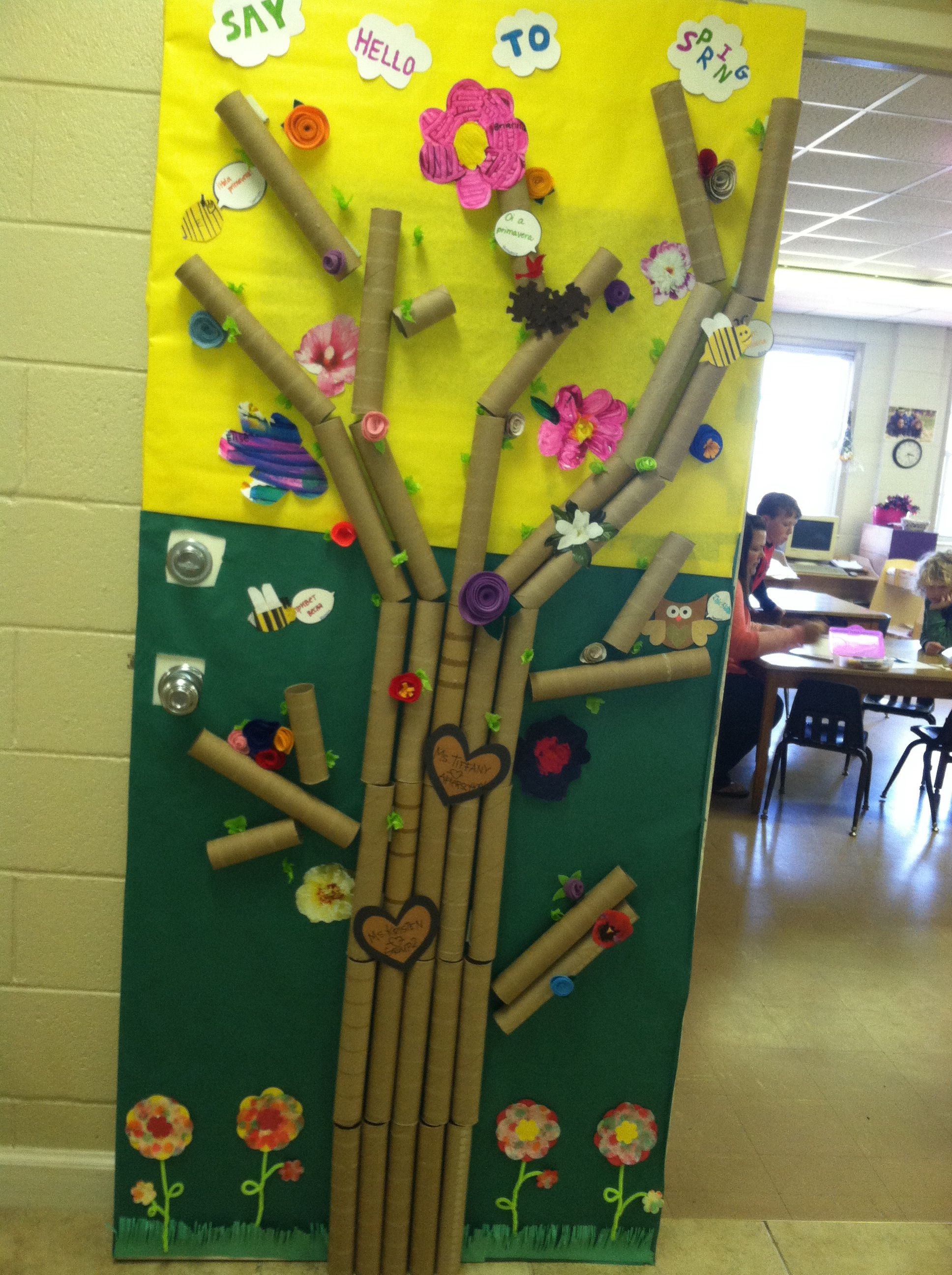Classroom spring door using a variety of recycled art materials