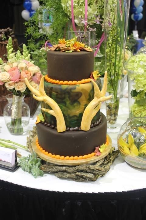 Our Lubbock Team S Fun Groom Cake At The 2014 Lubbock Bridal Showcase In January Let Us Show You Our Wedding Cakes Catering Food Camo Grooms Cake Grooms Cake