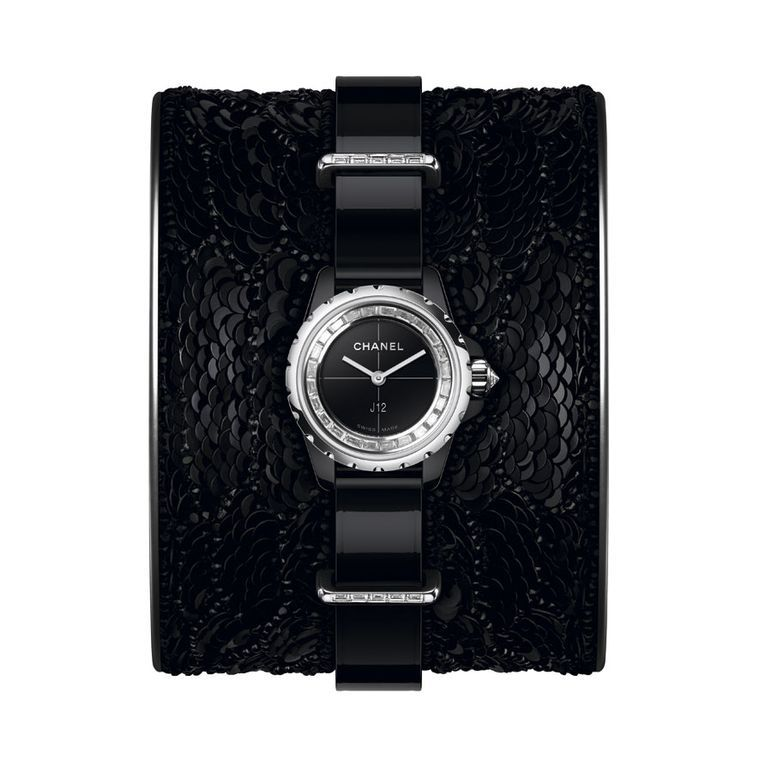 Following the monochromatic palette of the Chanel J12 XS collection, the black Lesage cuff is hand-embroidered with sequins and glass beads. Discover the most fashionable watches for women this year from the fashion brand: http://www.thejewelleryeditor.com/watches/badass-style-chanel-j12-xs-watch-collection/ #stylish