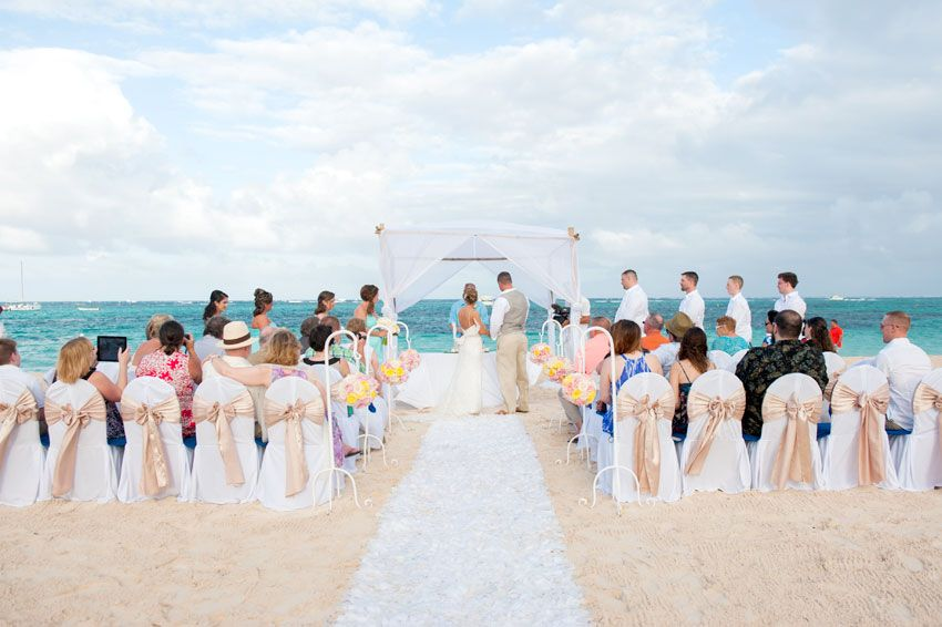 A Beautiful Beach Wedding With Bows Added To The Chairs Nowlarimarpuntacana Nowgardenpuntacana Dominicanrepublic