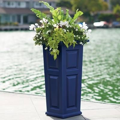 These All-Weather Footed Outdoor Planters are impeccably hand-patterned from solid, rust-free stainless steel. Burnished with a copper finish that will weather gracefully to a rich patina with time, these decorative urns showcase seasonal blossoms in distinctive style.Read our suggestions for what to plant.