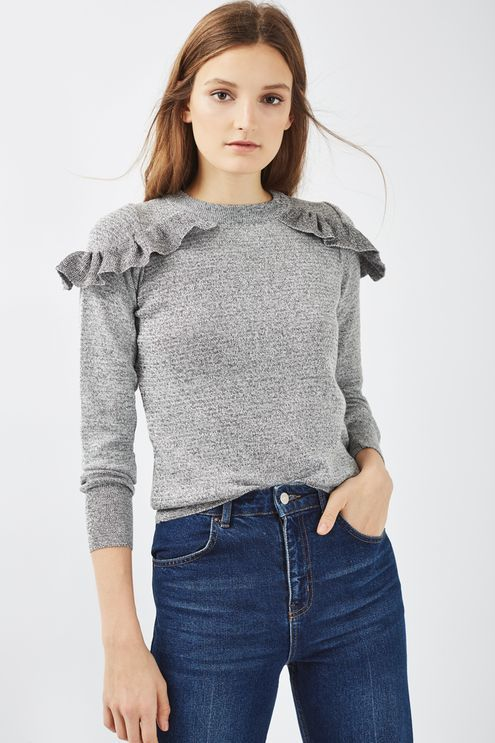 Add a flash of femininity to your casual-cool styles with this long sleeved jumper with ruffle shoulder detailing. Create a contrast look with a pair of dark wash jeans. #Topshop
