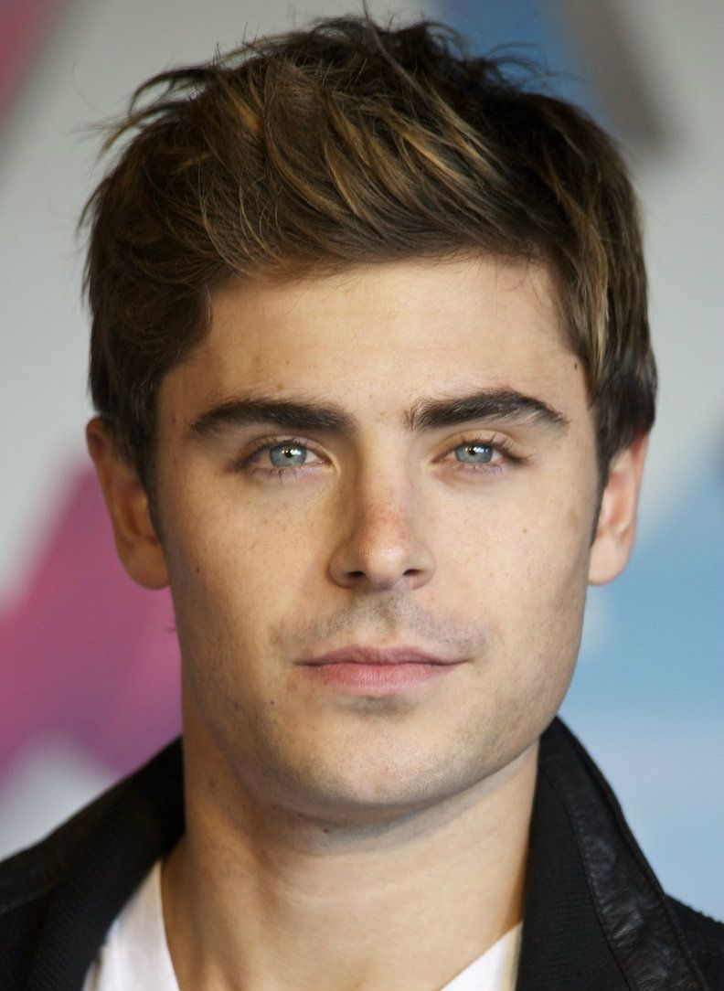 zac efron has an oblong face, and his hair helps shorten it