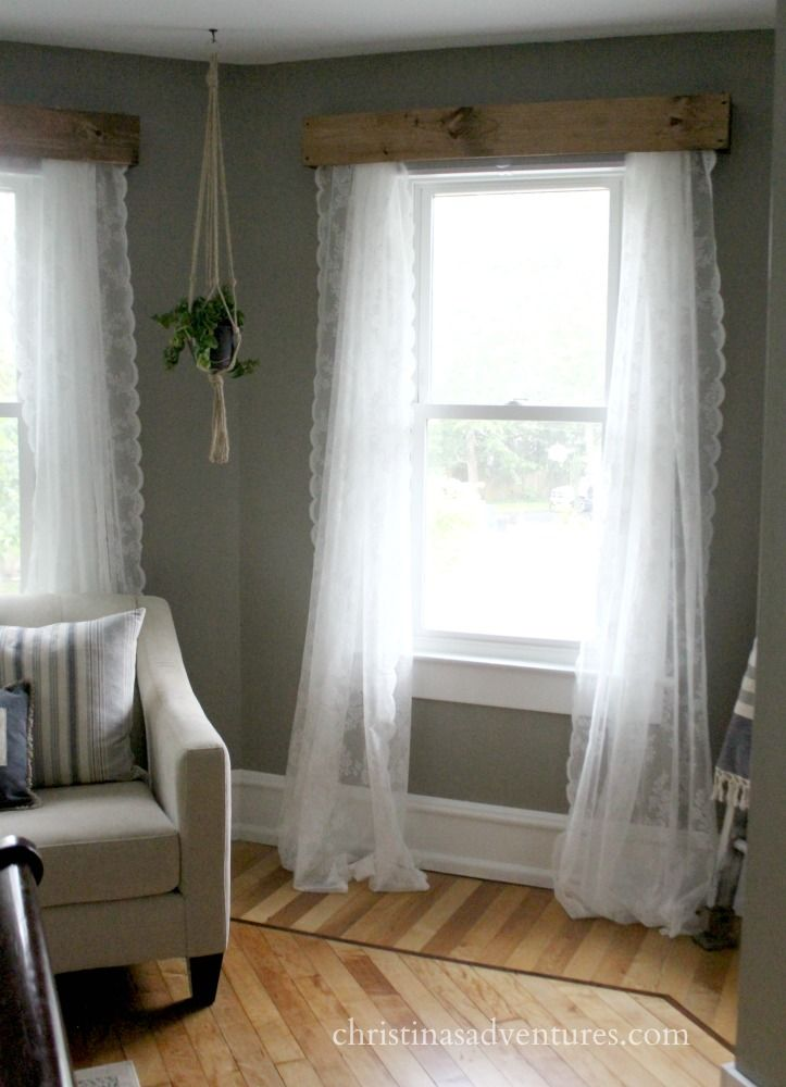 Wood valances with lace curtains and a