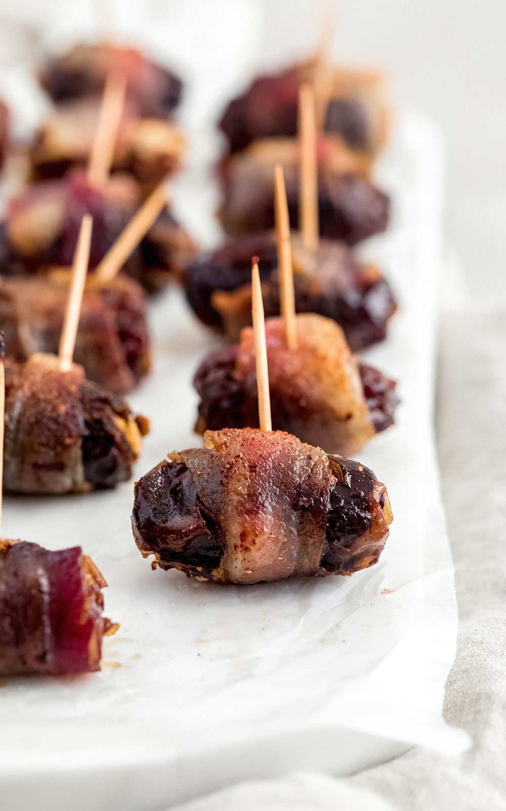 Sweet and savory bacon wrapped dark chocolate amp goat cheese stuffed dates make a fun, delicious app