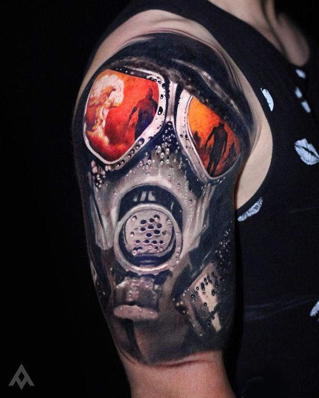 Stunningly Realistic Gas Mask Done On Guy S Upper Arm With An Explosion And People In The Orange Wars Like Refl Best Sleeve Tattoos Mask Tattoo Sleeve Tattoos