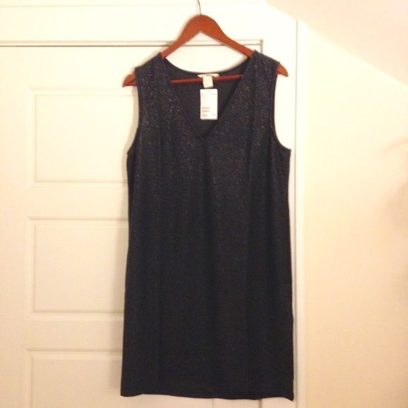 Black Sparkly Dress V-neck on front side, and round in back.  Actual size is a medium but it fits like a large.  Never worn (too big on me). H&M Dresses