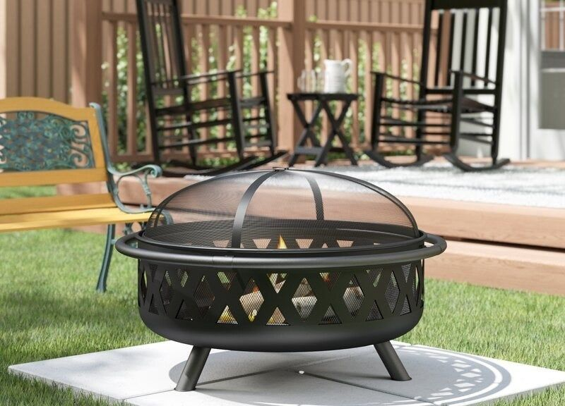 A weatherresistant steel wood burning fire pit with a