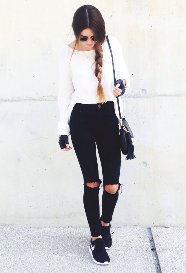 Black and white outfit with black sneakers and good hair
