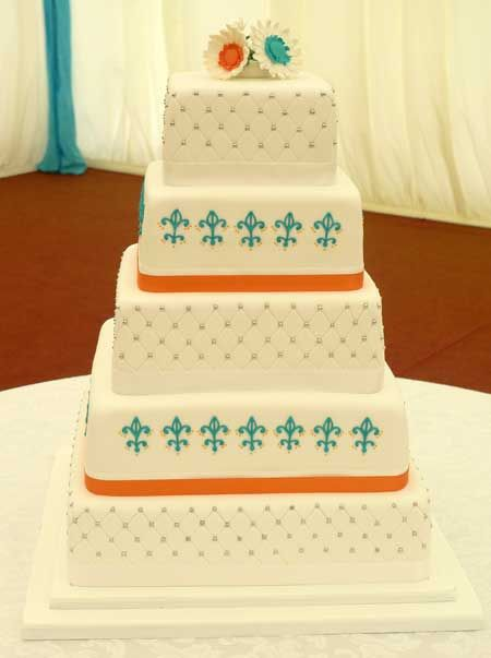 Turquoise & Orange decorated wedding cake by Genuine Cakes