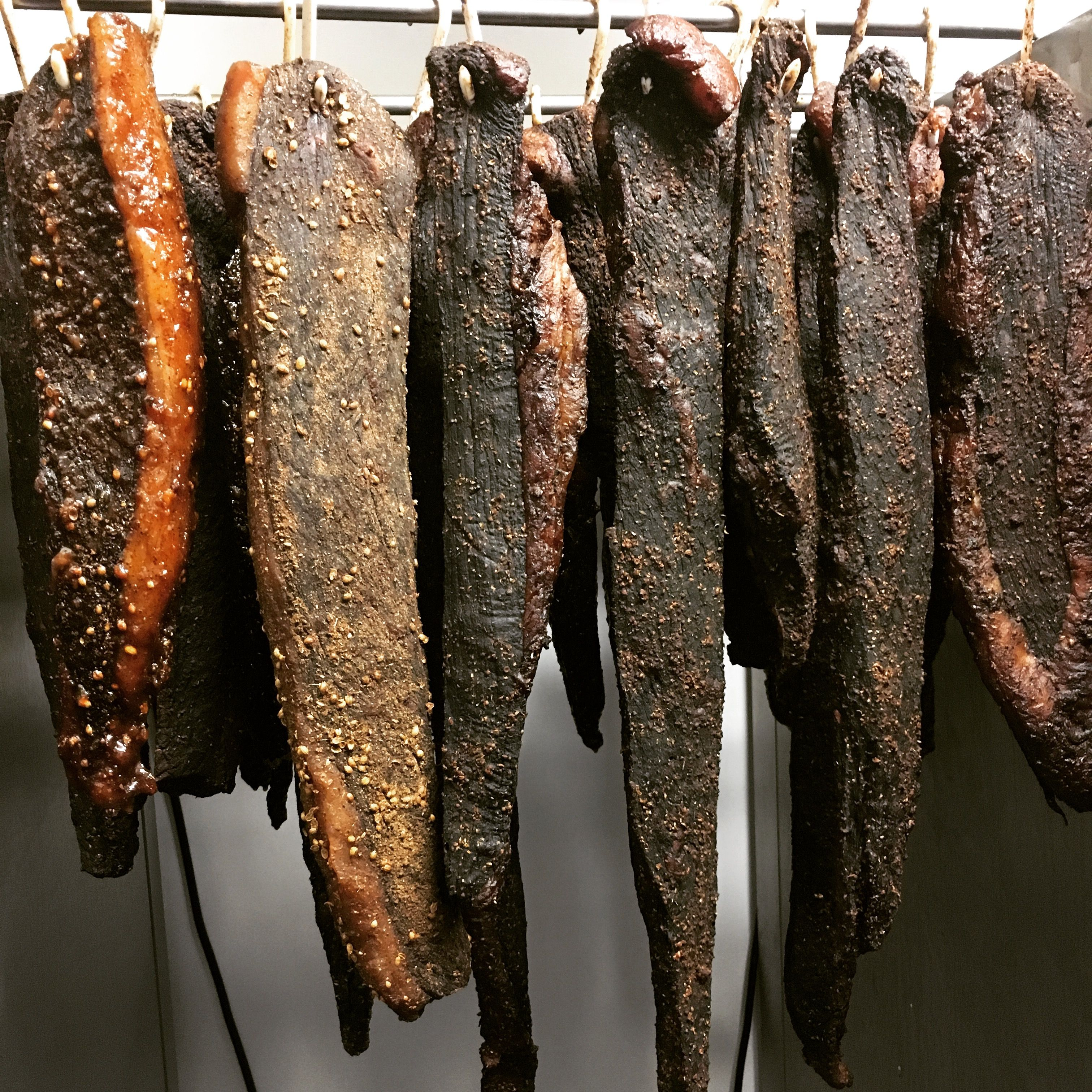 Various Wagyu Biltong sticks. The ones on the left have simple homemade Biltong spice (
