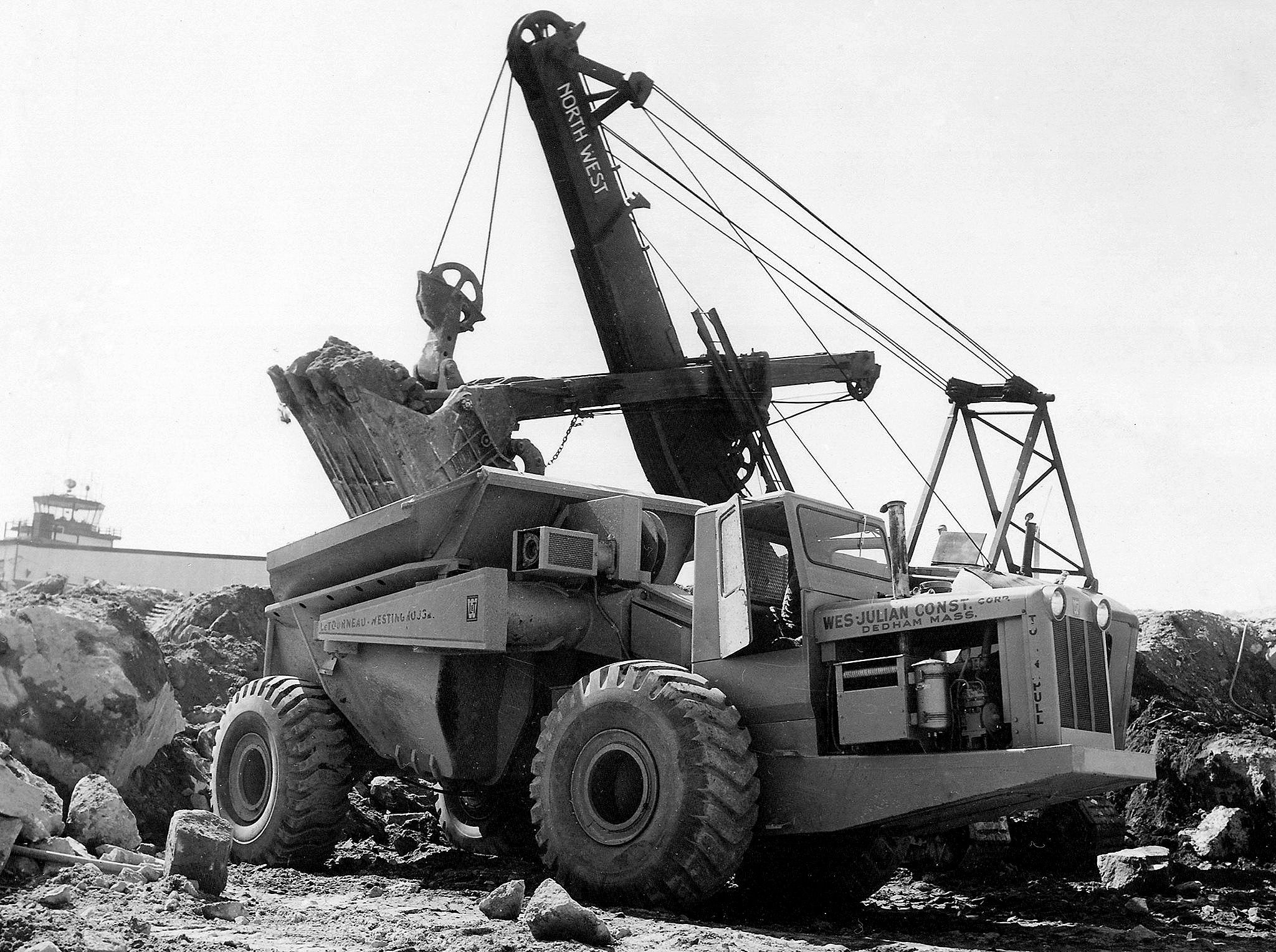 Great photo of a LeTourneau-Westinghouse C Tournarocker owned by the  Wes-Julian Corp, at work in Bedford Massachusetts, USA in 1956.