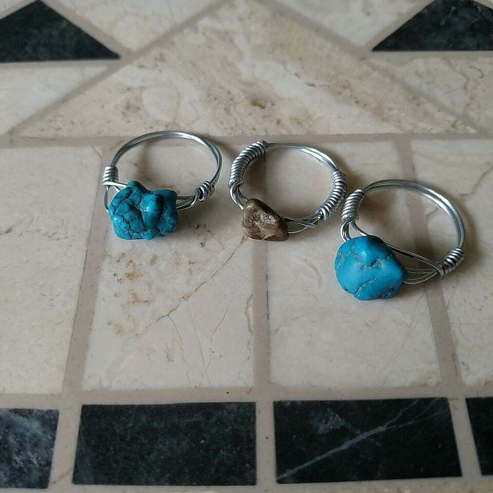 Turquoise wire wrapped bead rings.