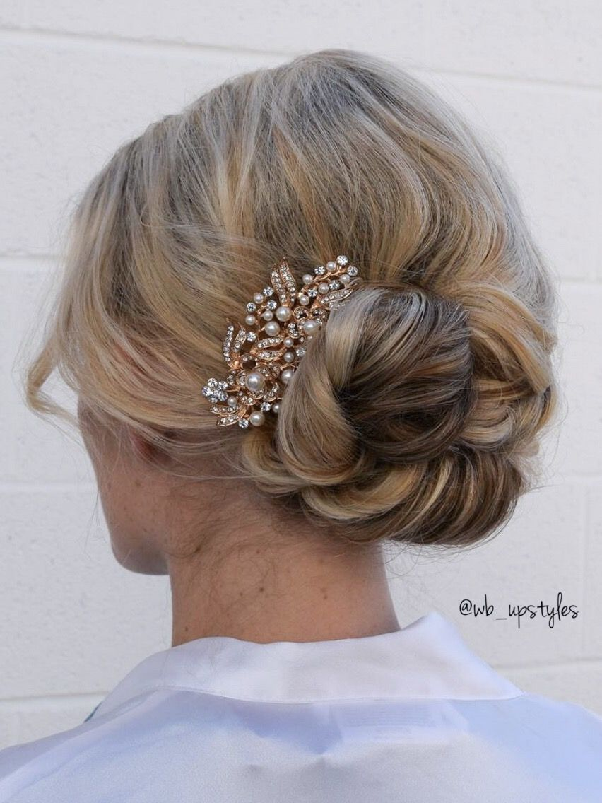 sophisticated curly bun for this bridal updo. hair by