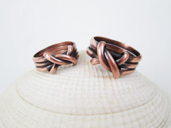 Three Bands Of Raw Copper Are Finished With A Knotted