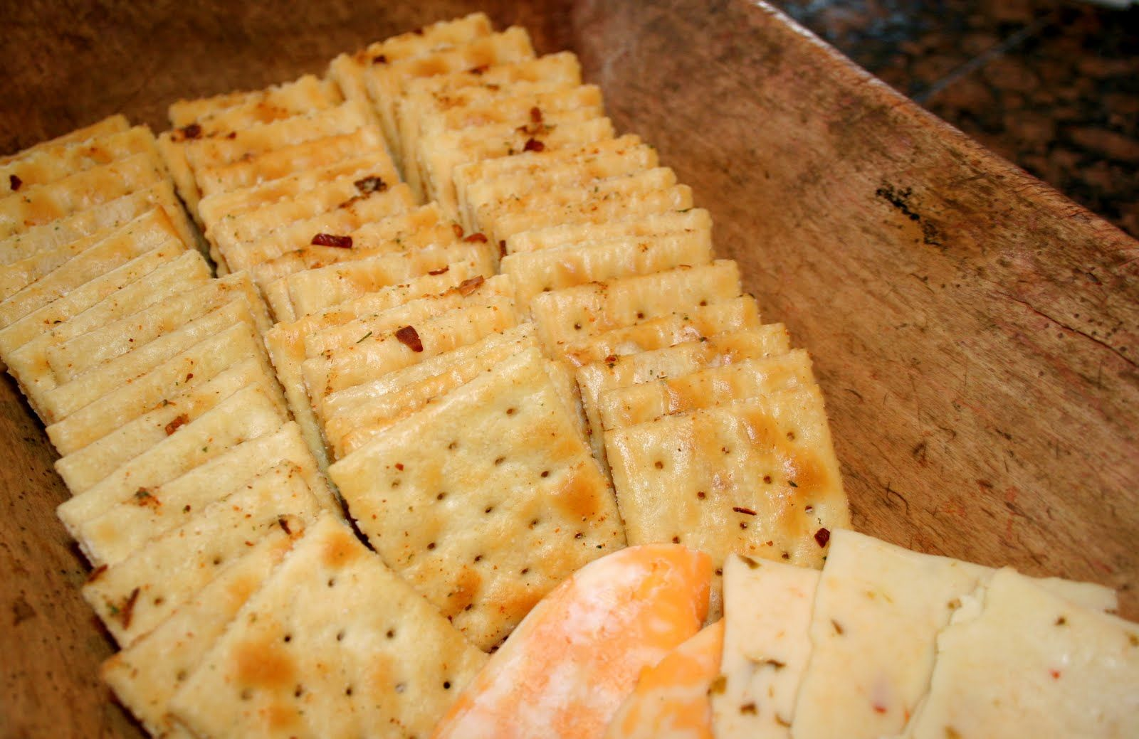 Magic Crackers!   Whisk together: 1 package of Hidden Valley Ranch Salad Dressing Mix 1 1/2 Cups Canola Oil 2 tsps. Garlic Powder 1-2 tsps. Cayenne Pepper 2 Tbs. Dried Red Pepper Flakes Pour over crackers! Cover tightly and flip! Do this for half an hour, flipping every 5 minutes!