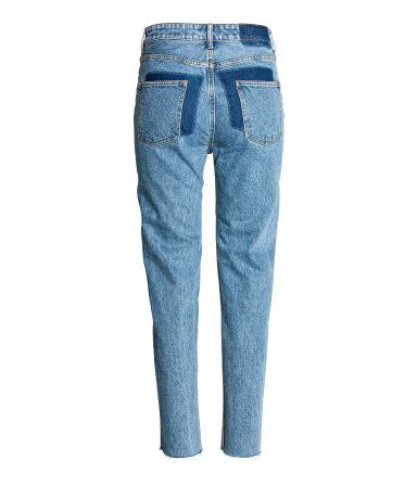 Denim blue. 5-pocket jeans in washed denim with darker sections at back. High waist and tapered legs with raw-edge hems.