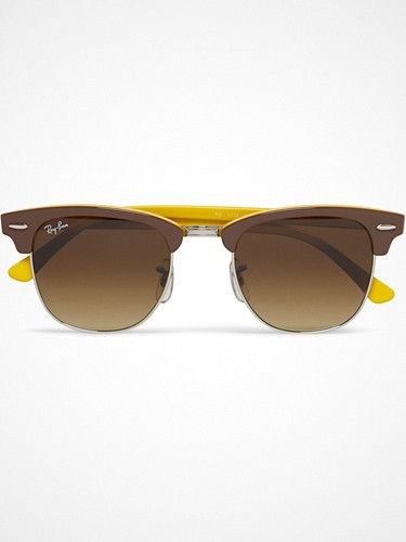 2012.07.09. Ray-Ban revisits its iconic 'Clubmaster' sunglasses with this two-tone design in a retro-inspired mustard-yellow and brown palette. Bad ass.