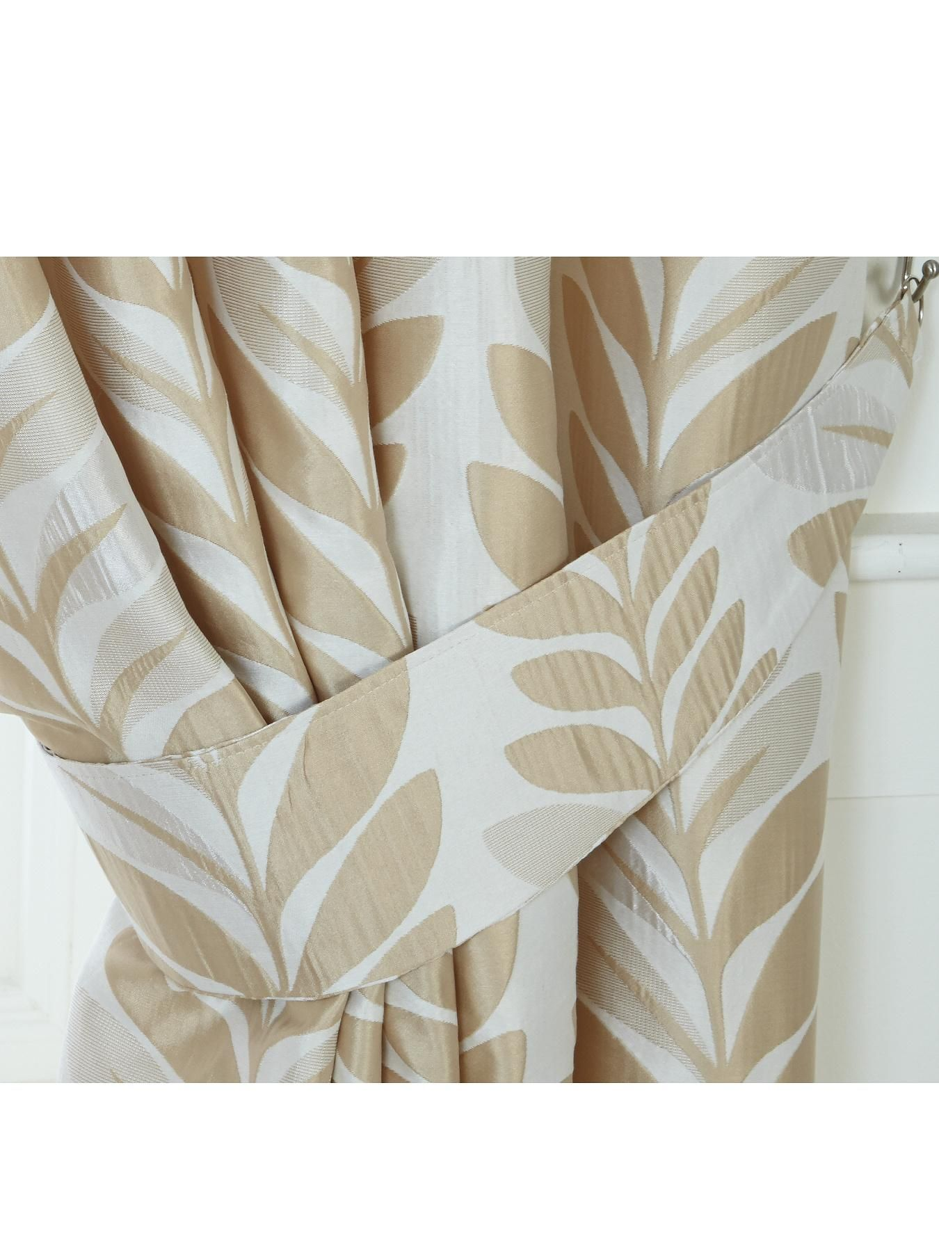 Palm Pair of Tie-Backs Ensure your Palm curtains (see item number 4XMUD) look as stunning in the day as they do at night with these matching tie-backs. They flaunt a woven jacquard palm leaf design in a choice of duck egg, gold or natural to perfectly co-ordinate with your room.Spread the style with with matching cushion covers (4XMUM), available separately.Useful info: Palm Tie-BacksPairWoven jacquard palm leaf design3 colours choicesCo-ordinating items available separatelyColours: Duck…