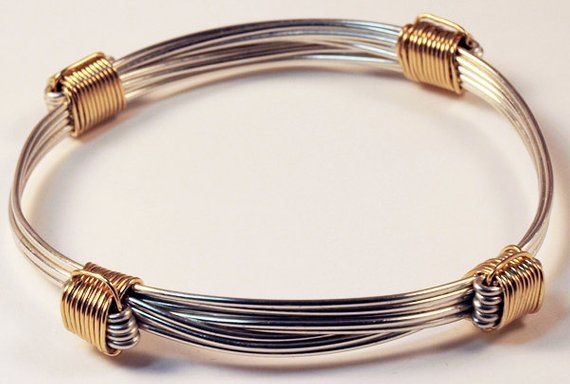 94839da1c Traditional sterling silver African elephant hair bracelet with 4 gold knots