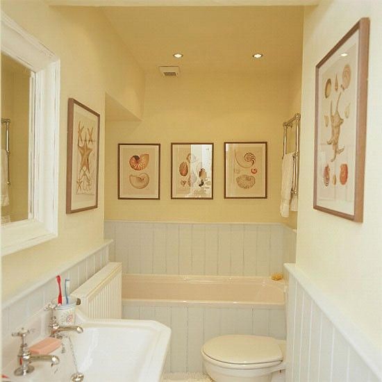 Yellow Bathroom With White Suite And Tongue And Groove Panelling