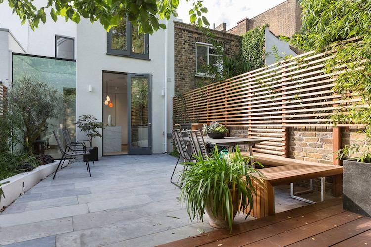 Palissade jardin pour délimiter lu0027espace et préserver lu0027intimité - banc en pierre pour jardin