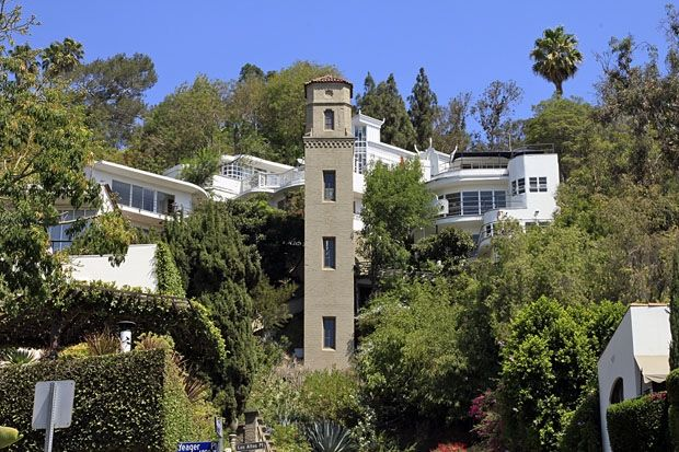 Like a hillside fortress the hollywood high tower is the for Fortress homes