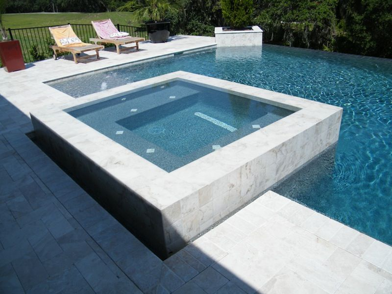 Raised outdoor infinite spa hot tub pool and spa for Pool design with hot tub
