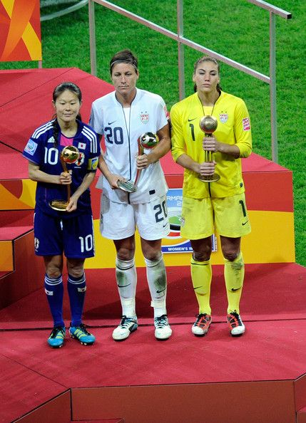 Homare Sawa (L) of Japan receives the Best Player trophy ...