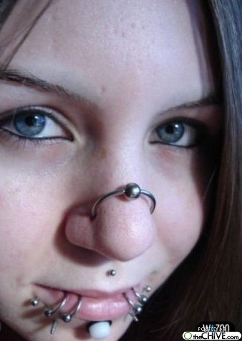 Lisa Phillips Barton Sweatland You Think I Have A Lot Of Piercings At Least I Dont Look Like This Crazy Piercings Double Nose Piercing Nasallang Piercing