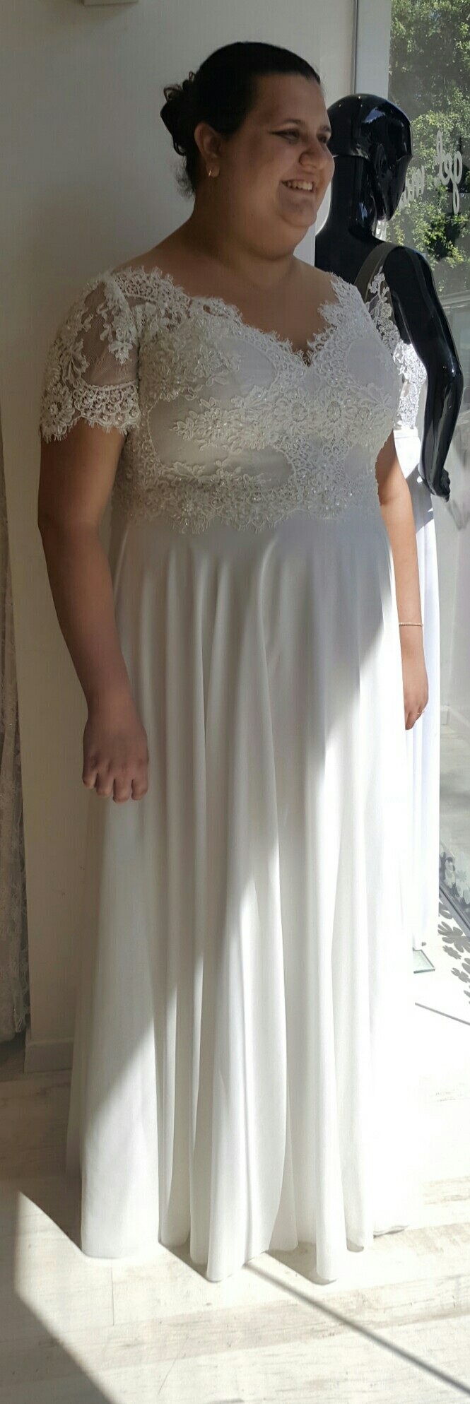 Boho bride in plus size wedding gown with short sleeves anx simple