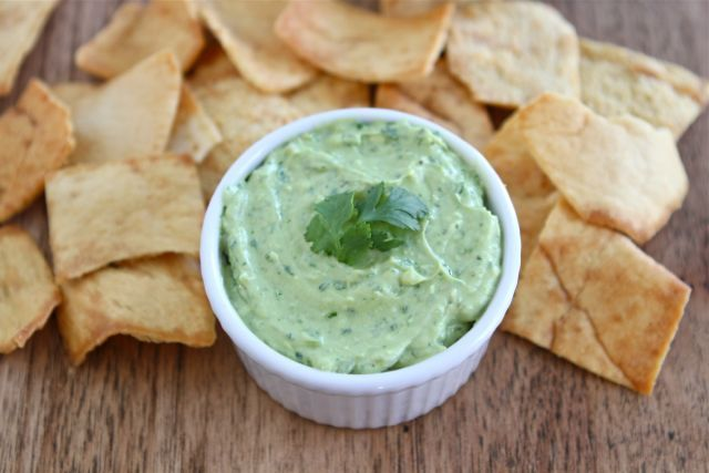 Creamy Avocado Yogurt Dip - a lighter dip that is easy to make & great for parties! Looks super yummy with lots of flavor, including lime & cilantro.
