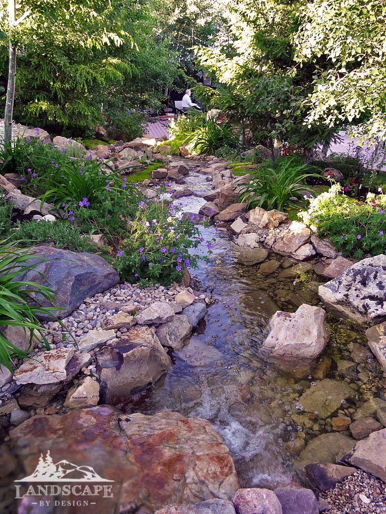Backyard stream designed to look like nature built it