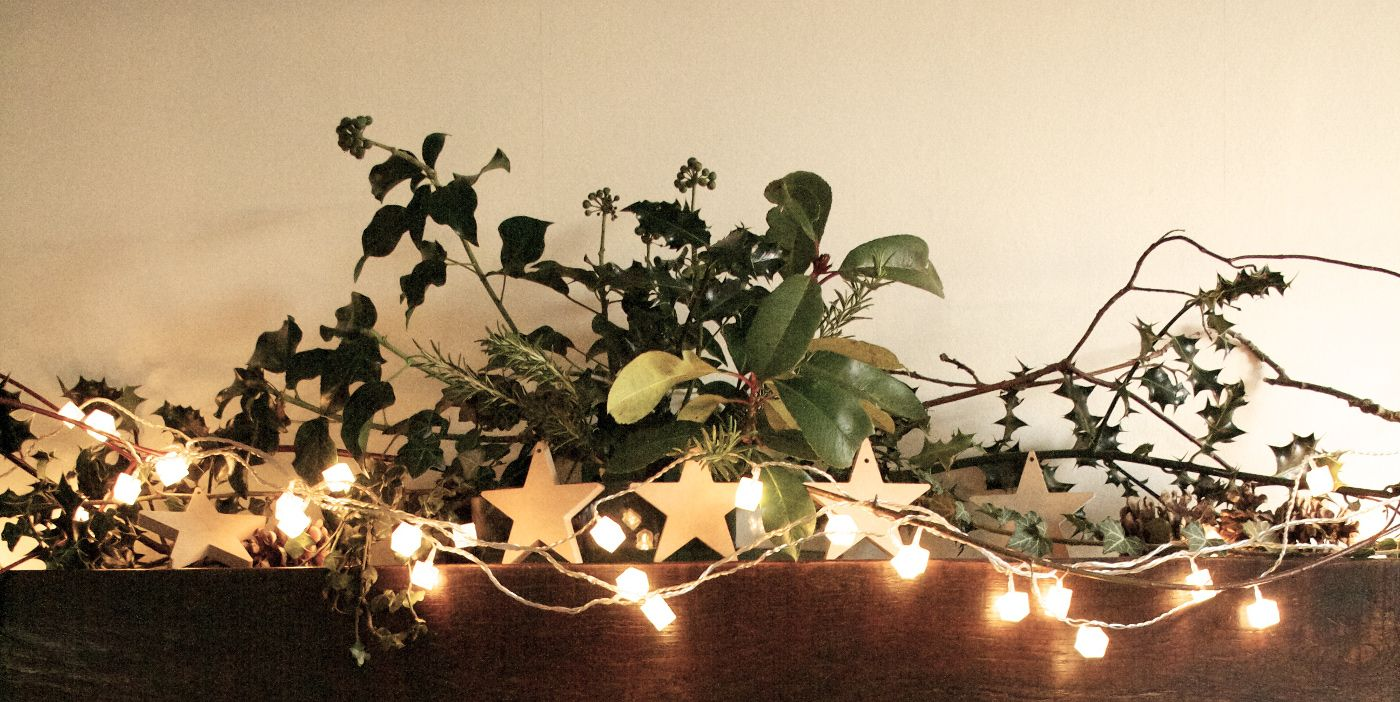 A Christmas Mantelpiece Decoration With Holly And Ivy From Our