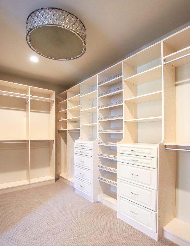 Giant master closet with drum lighting  Small master closet