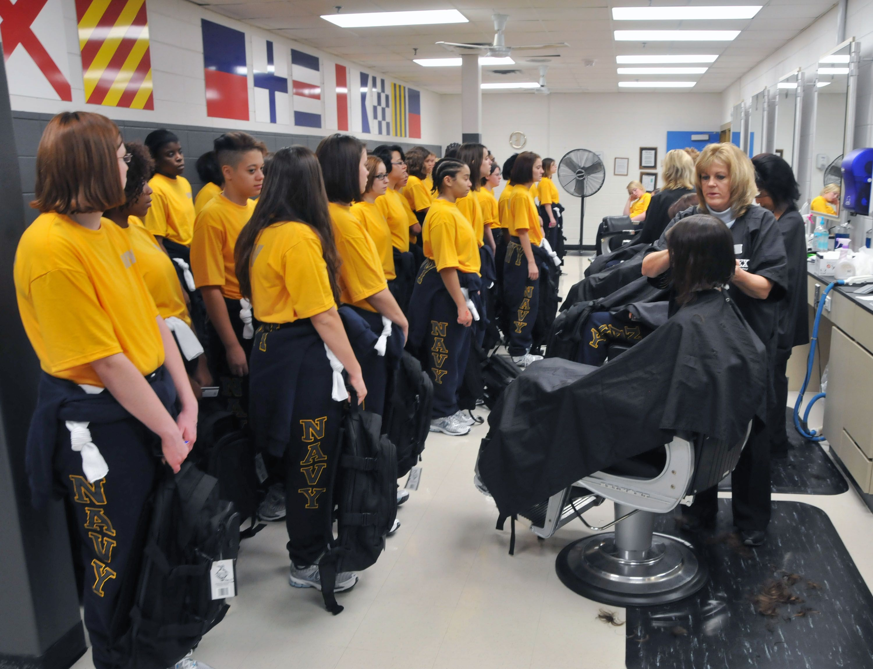 New Female Recruits Receive Their First Haircuts At The Navy