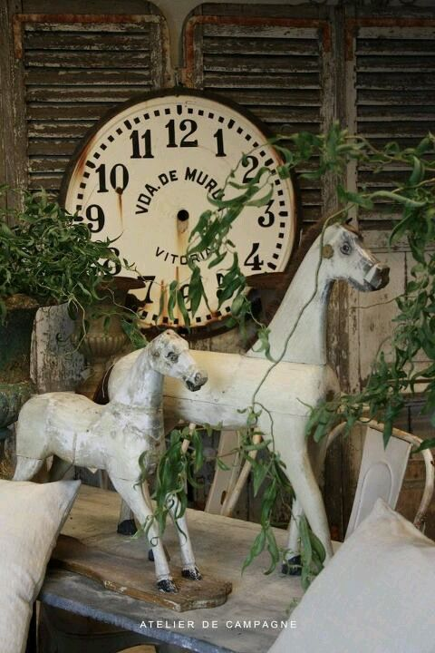 folk horses with clock face....