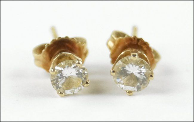 A PAIR OF DIAMOND AND 14 KARAT YELLOW GOLD STUD EARRINGS. Lot 150-7237 #jewelry