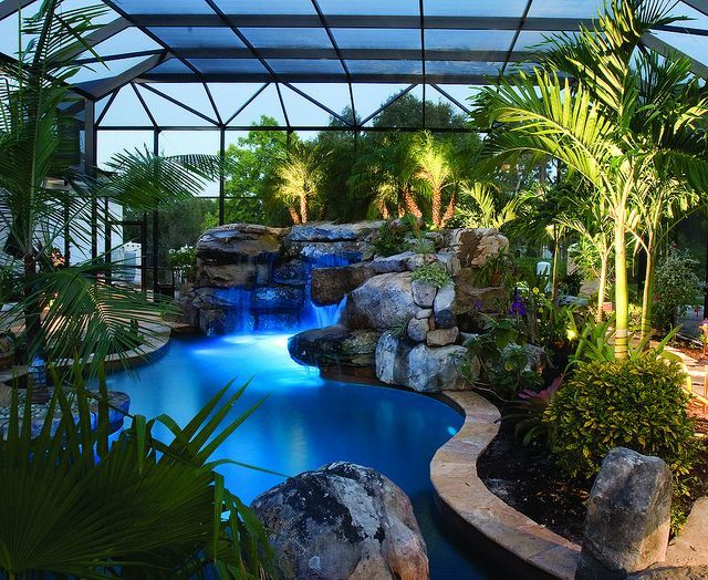 Looking at grotto waterfall from spa stone patios for Indoor garden pool
