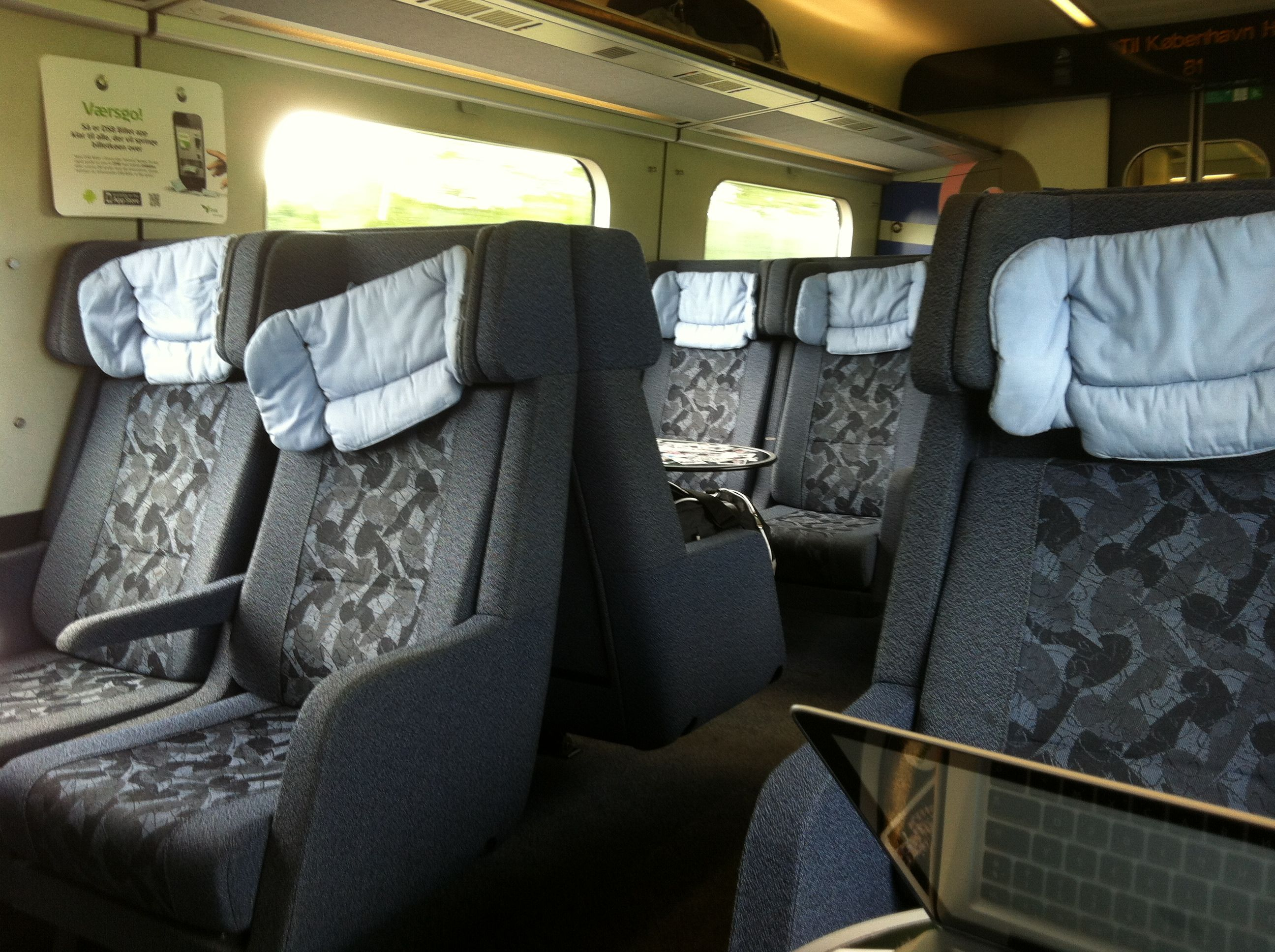 I am convinced that Danish train seats look like happy old people. Look at the head cushions!! - Denmark